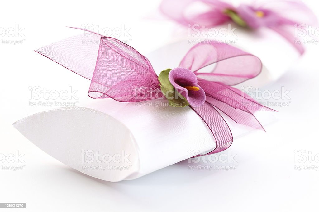 White wedding favor box with a pink ribbon royalty-free stock photo