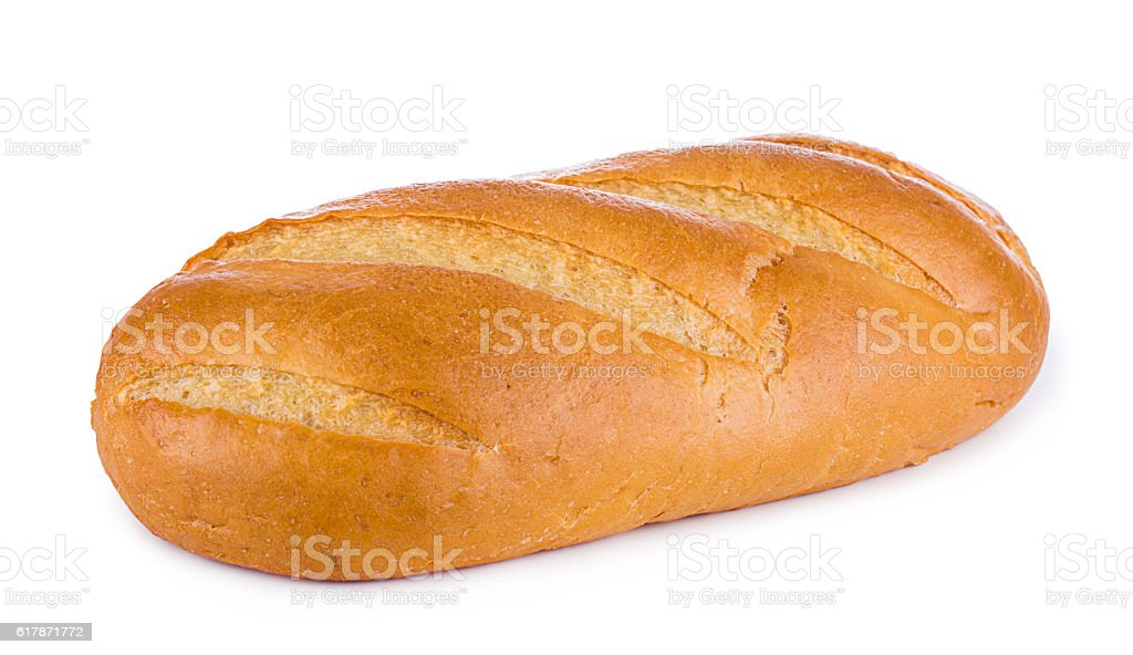 White wheaten long loaf on a white background. Bread close-up. stock photo
