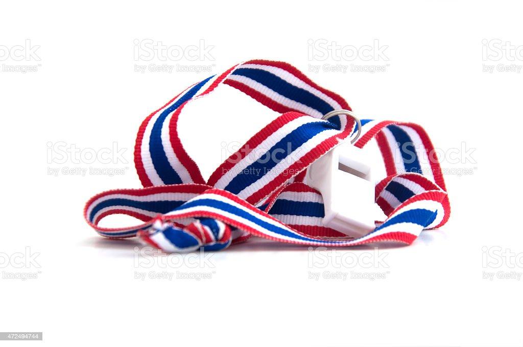White whistles with Thailand national flag lanyard on white background stock photo