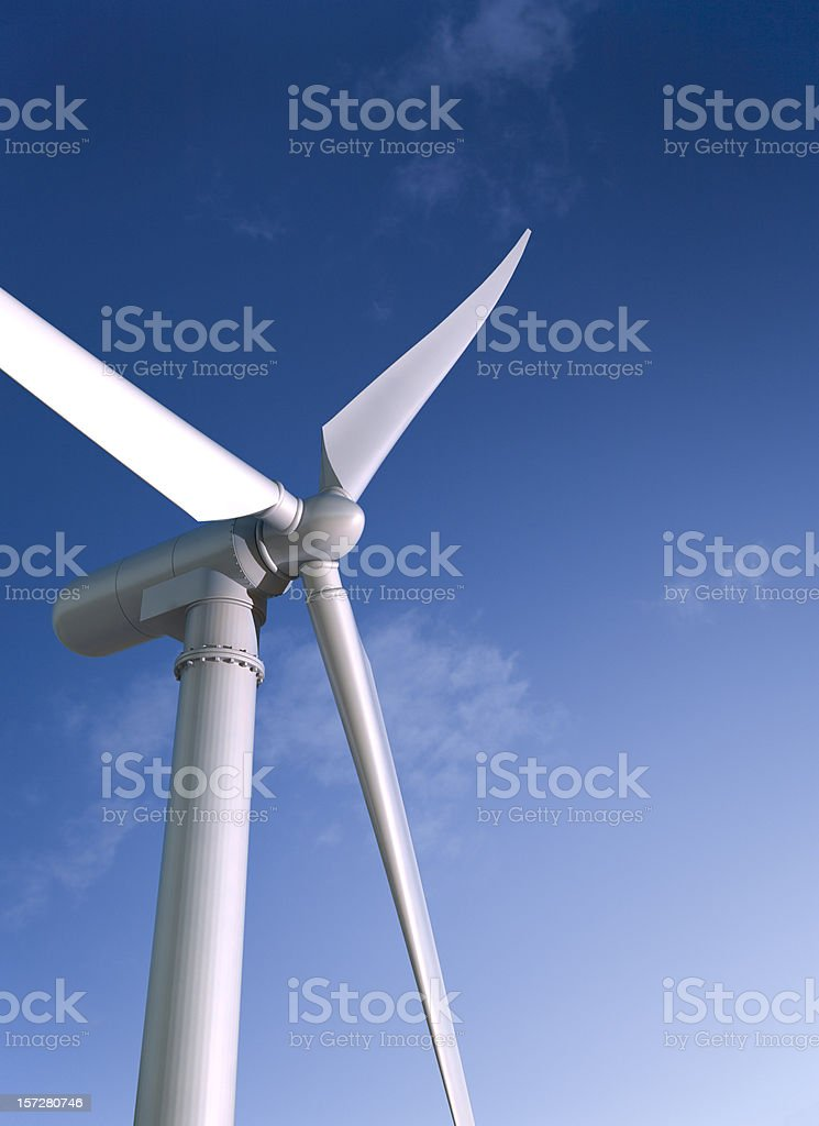 White wind energy windmill against a blue sky royalty-free stock photo