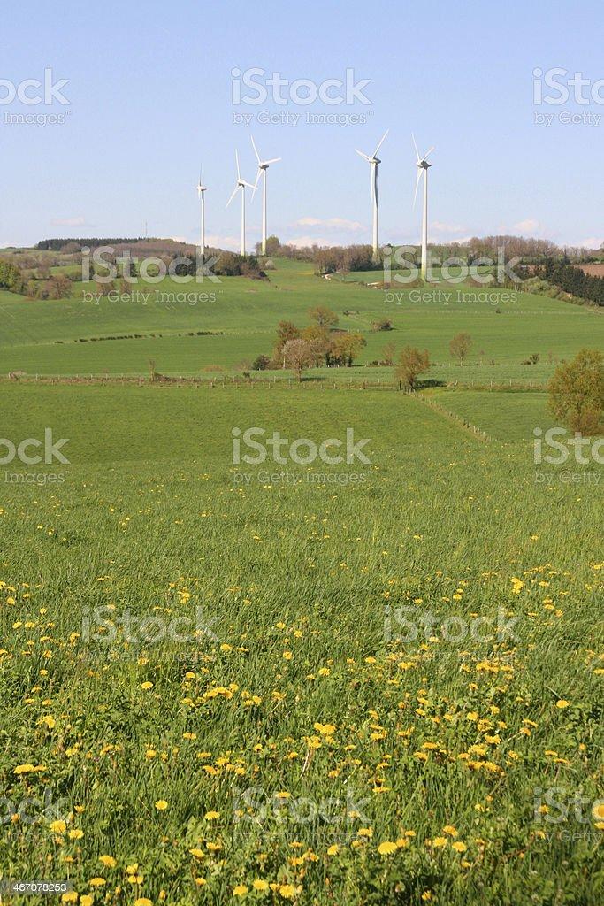 White wind turbines generating electricity on blue sky, Aveyron, France royalty-free stock photo