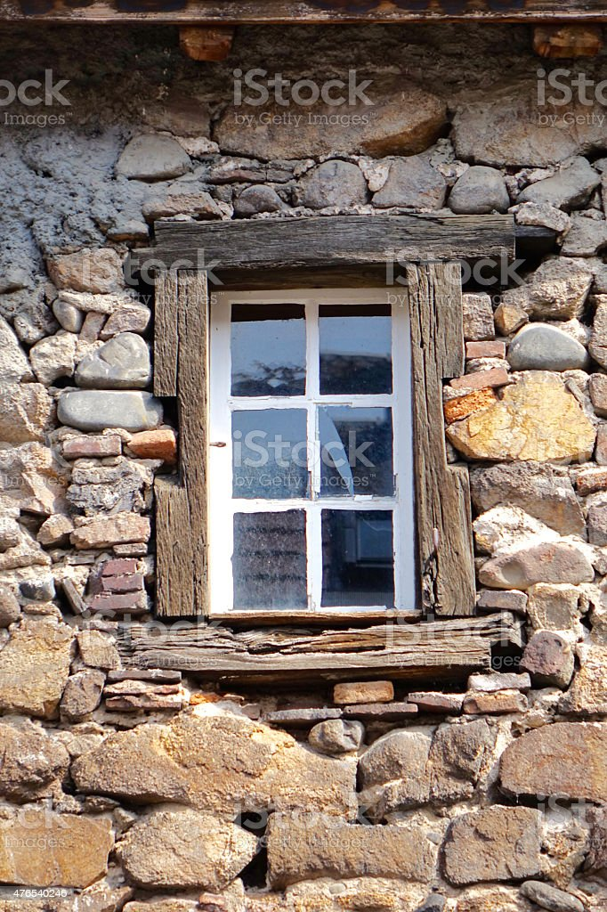 white window of an old castle stock photo