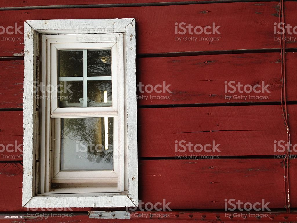 White window on a red side barn stock photo