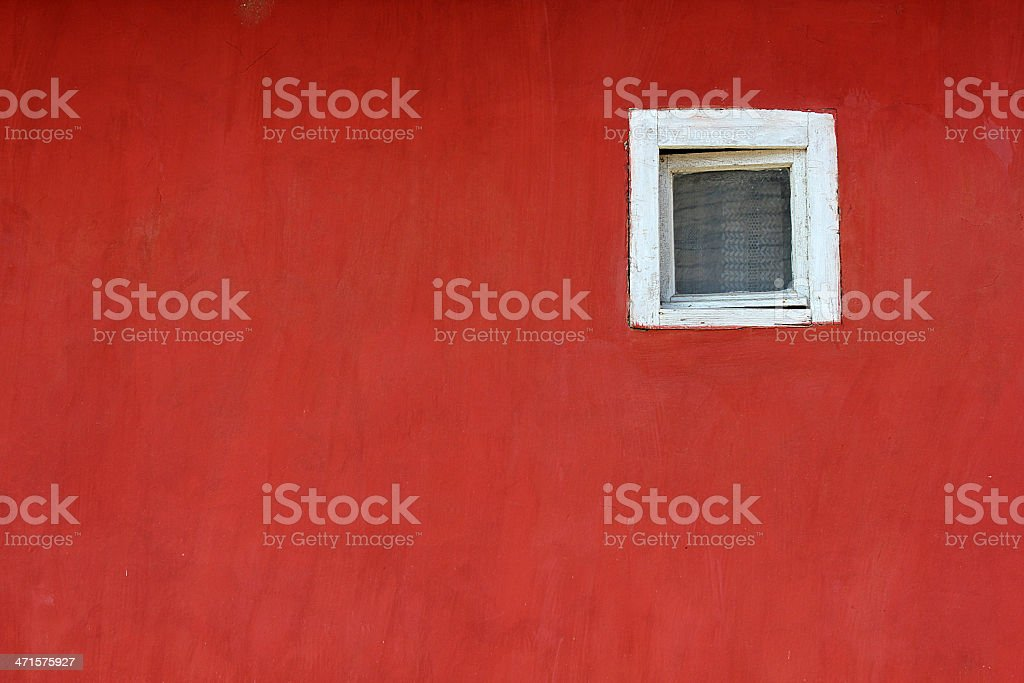 White window on red wall on the street royalty-free stock photo