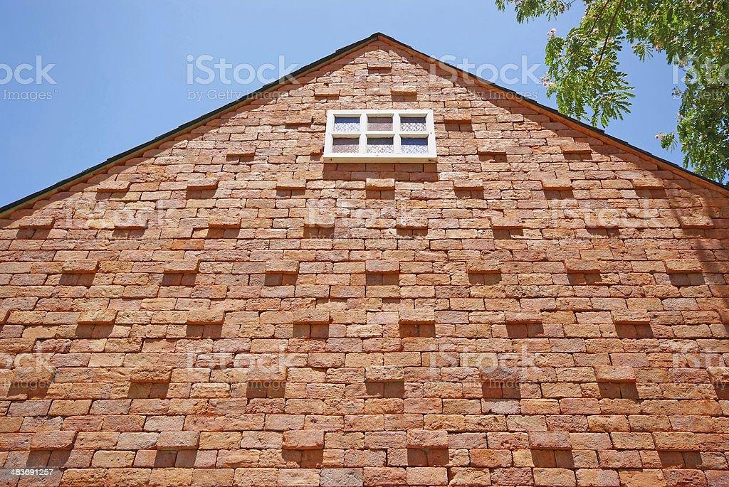 White window on the brick building stock photo