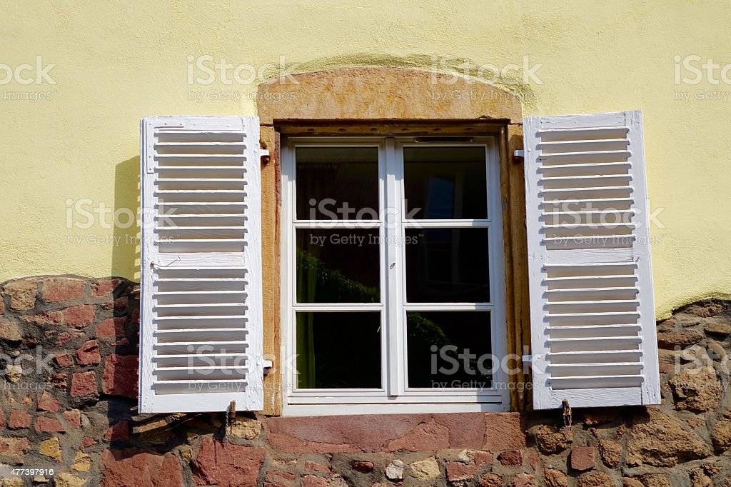 white windows shutter of a half-timbered house stock photo