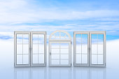 White windows with blue sky and clouds on background