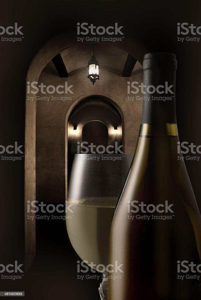 White wine and bottle in wine cellar. royalty-free stock photo