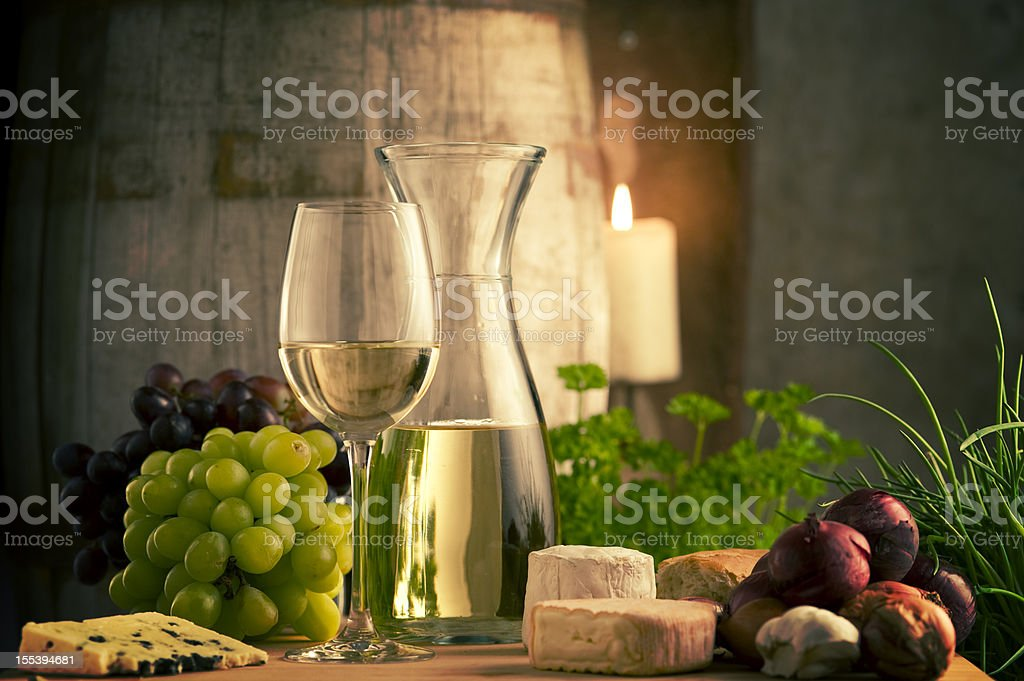 White Wine and food in a winecellar stock photo