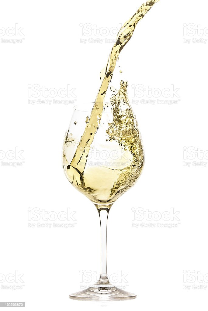 White wine being poured into a glass and splashing out stock photo