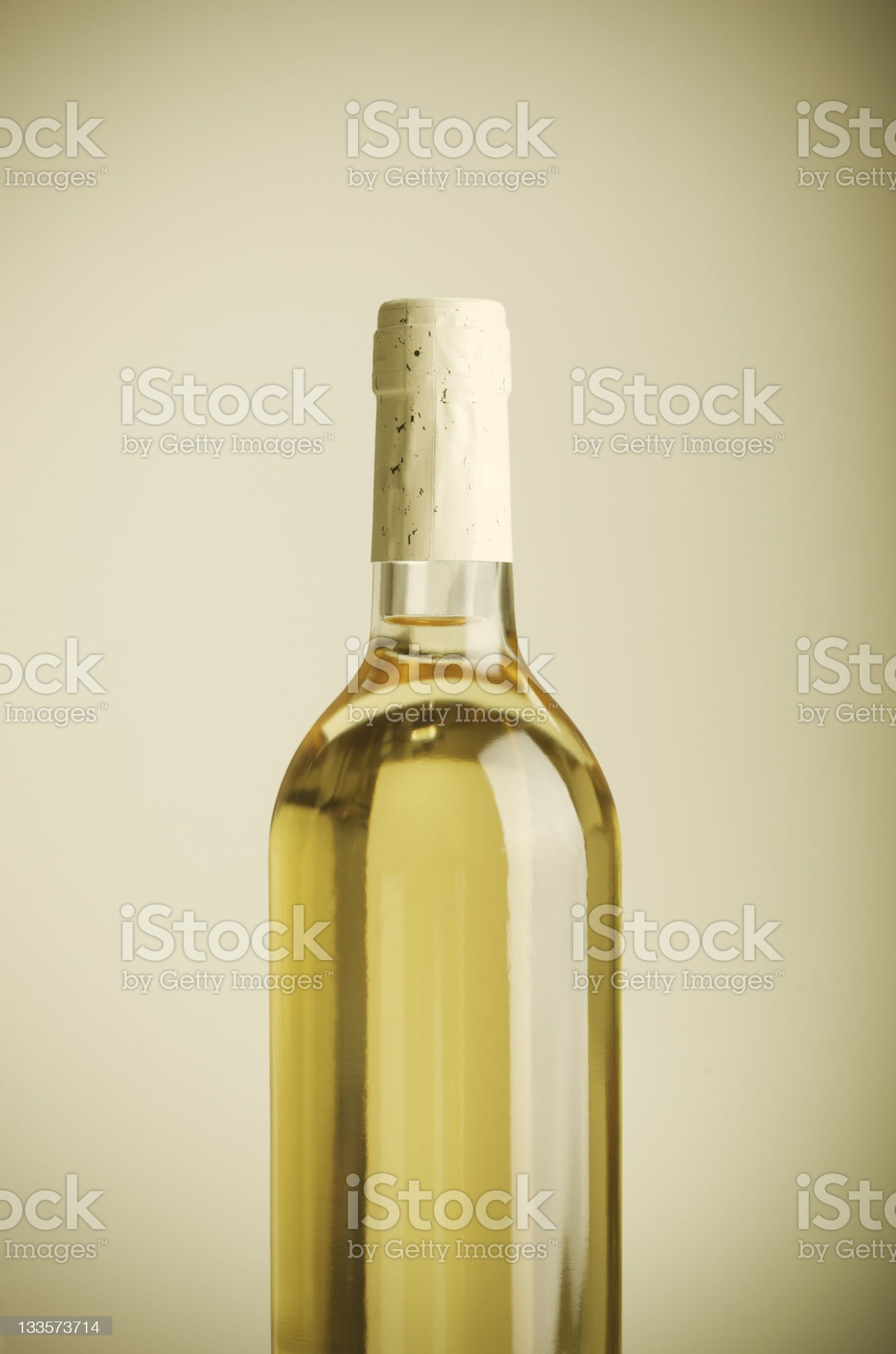 White wine bottle on beige background _ vertical royalty-free stock photo