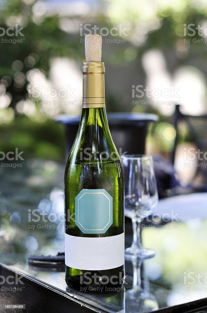 White wine bottle on table stock photo