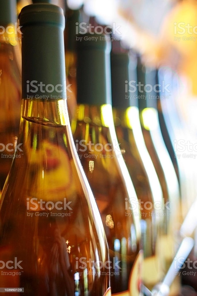 White Wine Bottles - In A Row royalty-free stock photo