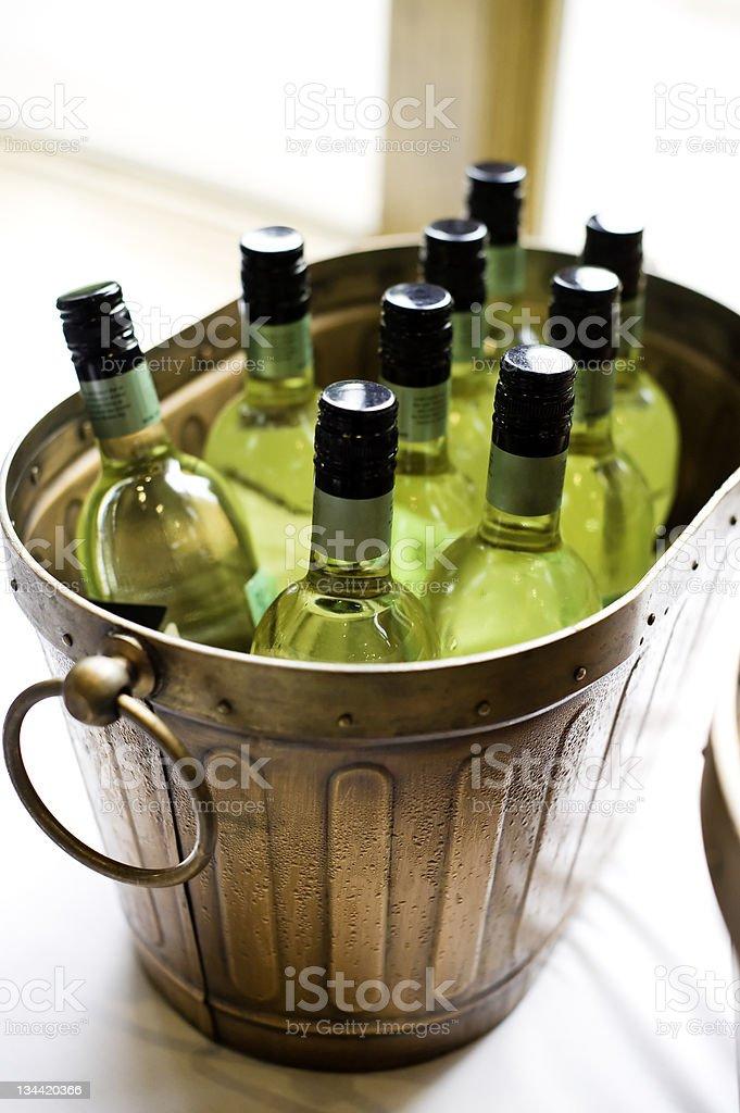 White WIne Bottles in Bronze Ice Bucket royalty-free stock photo