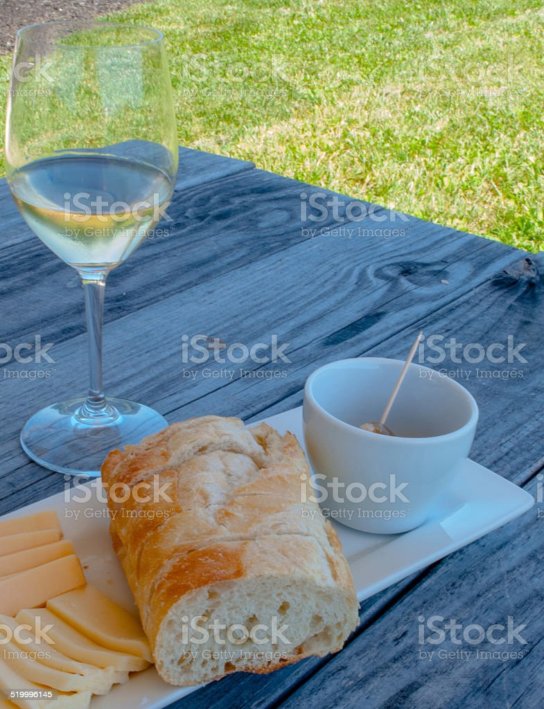 White Wine, Cheese, and Bread Picnic stock photo