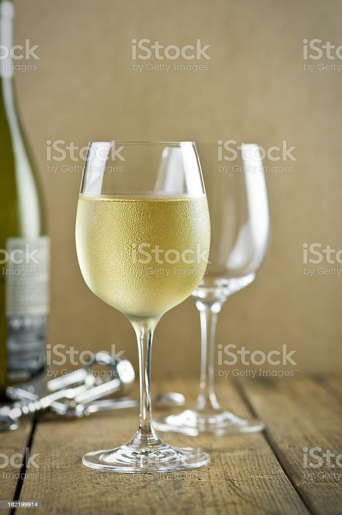 White wine, corkscrew, bottle, table royalty-free stock photo