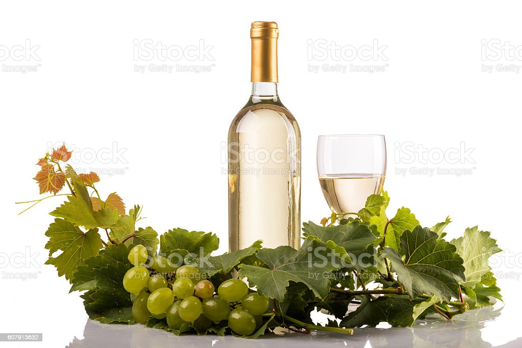 White wine glass and bottle on white background stock photo
