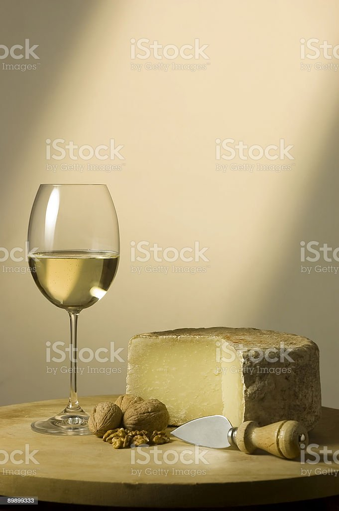 White wine glass and cheese royalty-free stock photo