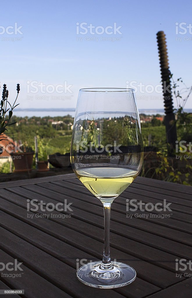 White wine glass on table stock photo