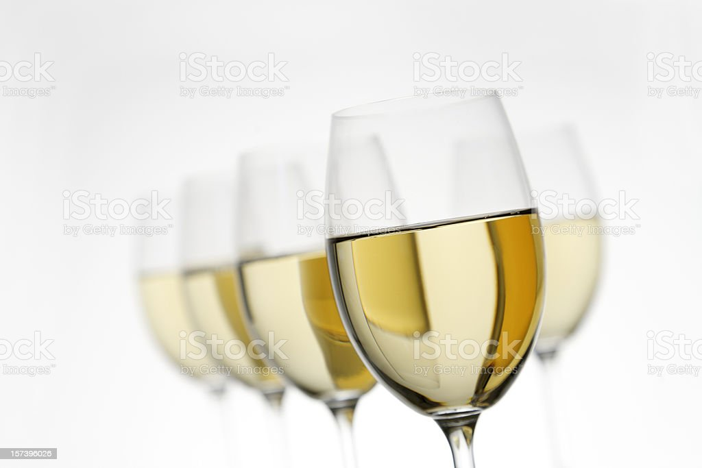 White wine glasses fading on a white background stock photo