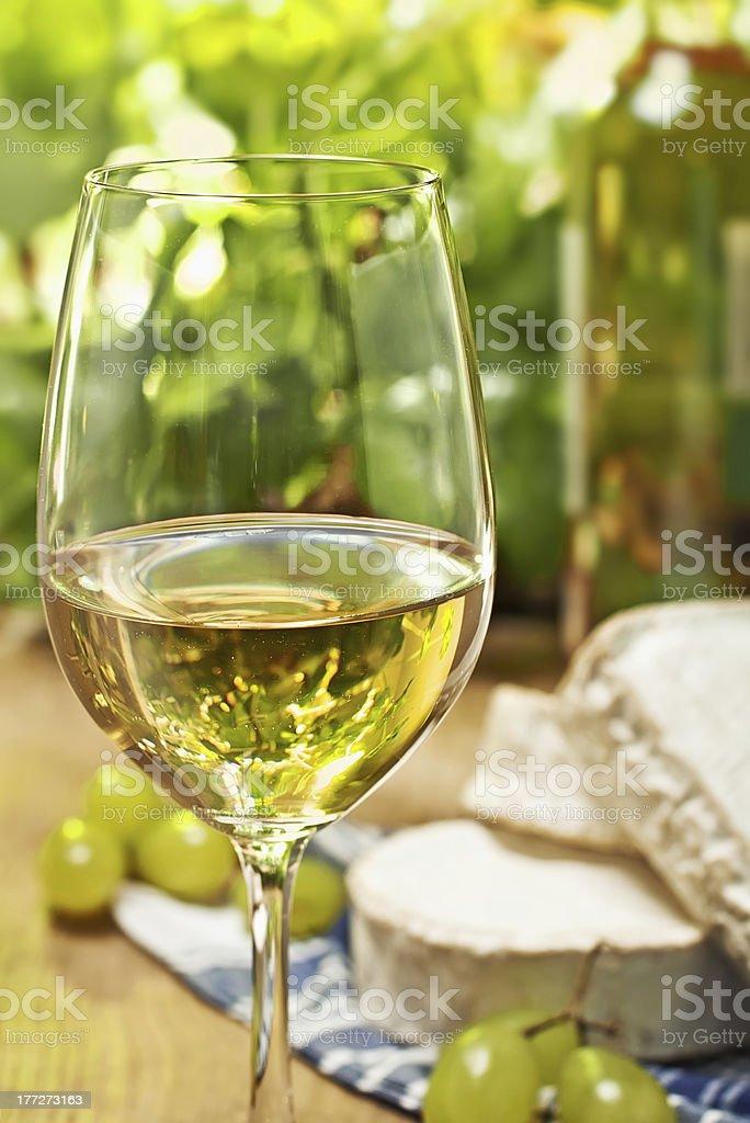 White wine, grape, Brie and Camembert cheeses stock photo