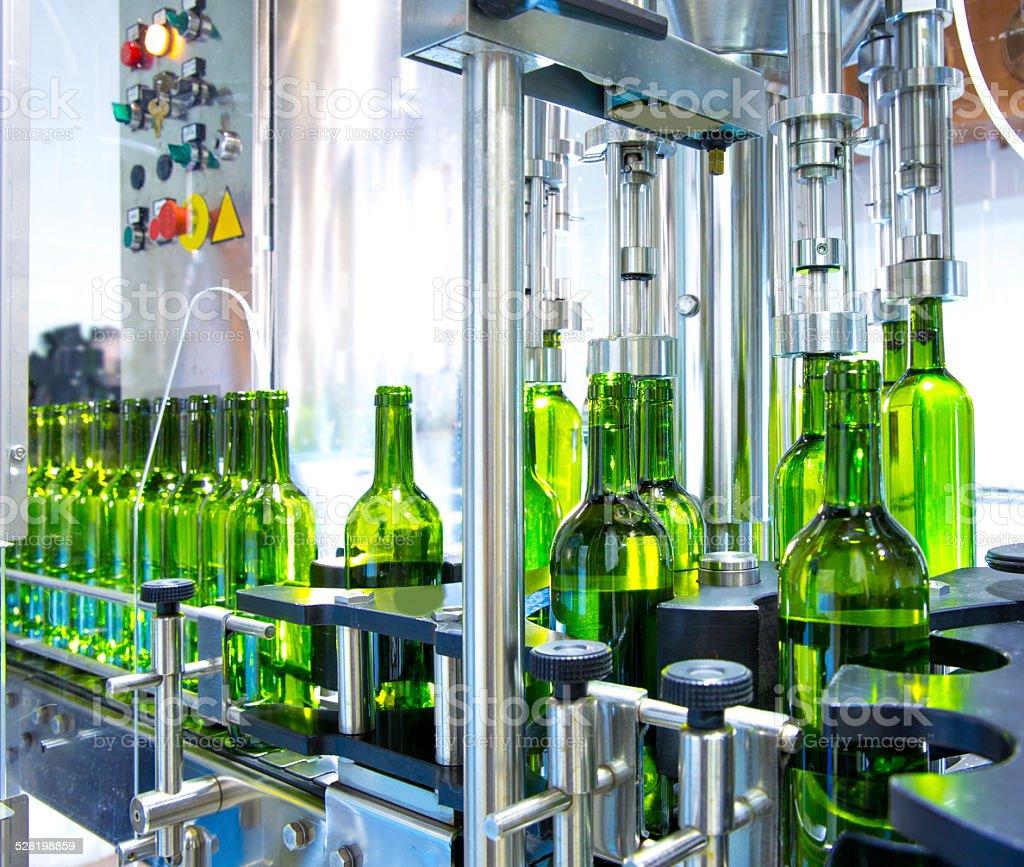 white wine in bottling machine at winery stock photo