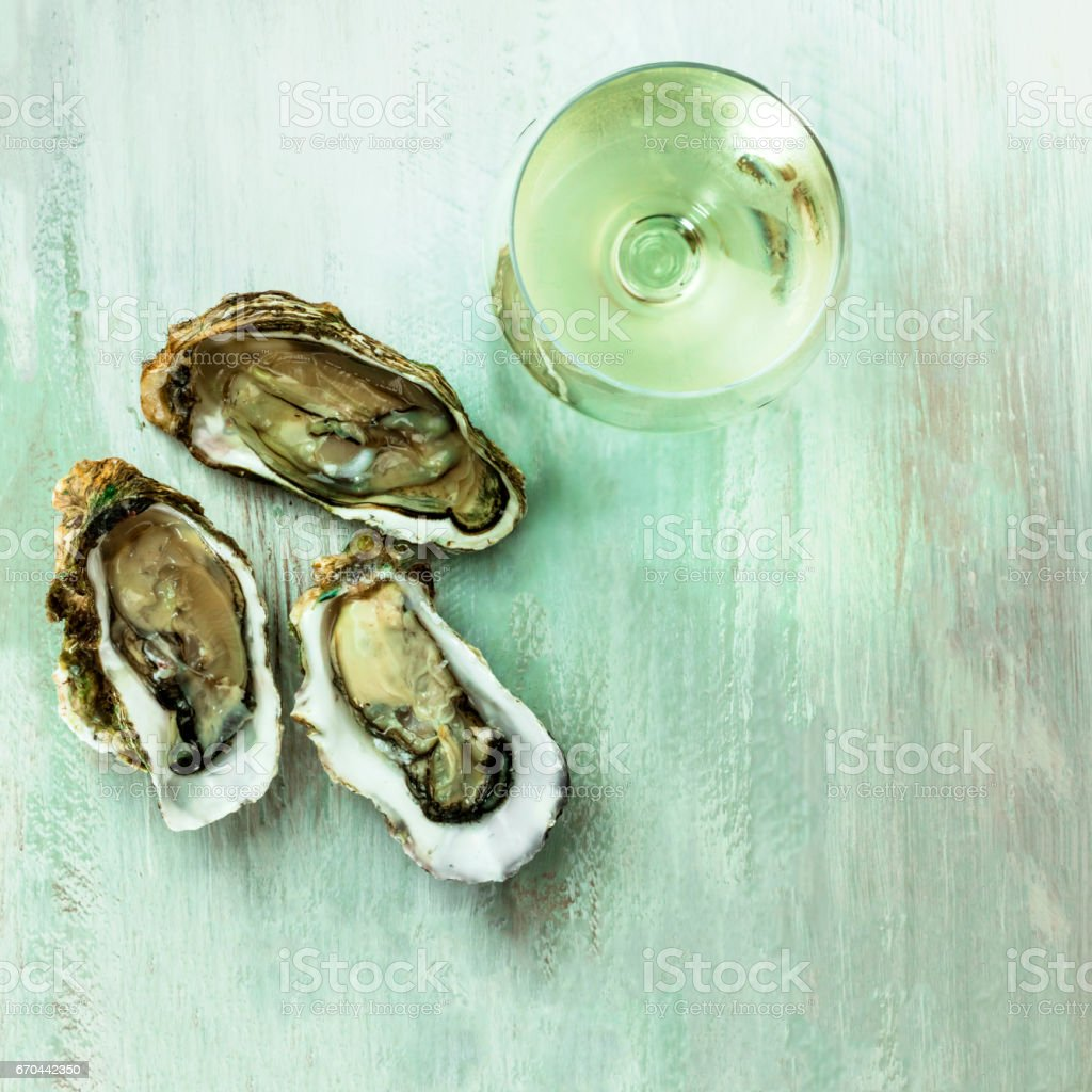 White wine, oyster, and lemon photo with copyspace stock photo