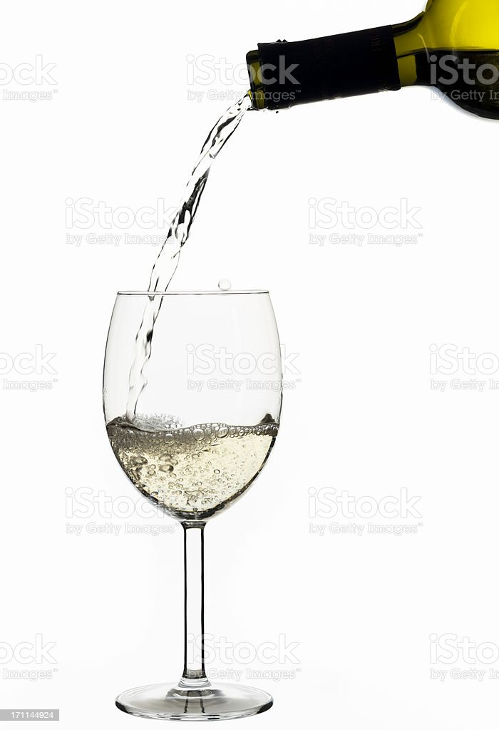 white wine poured out of a green bottle - isolated royalty-free stock photo