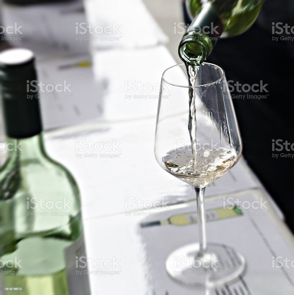 White wine pouring down from a bottle royalty-free stock photo