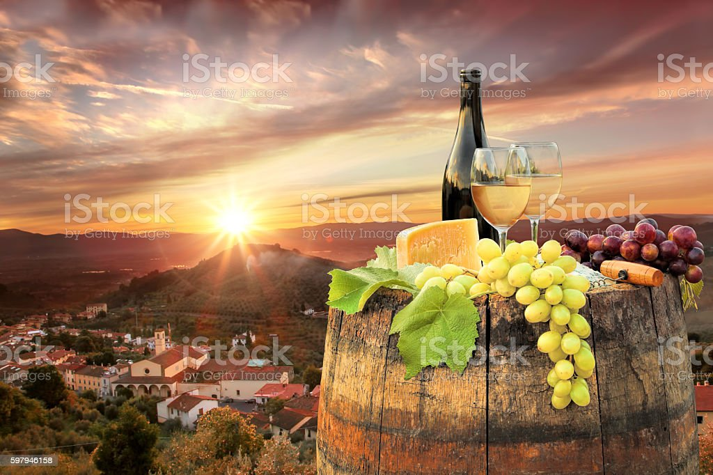 White wine with barrel on famous vineyard in Chianti, Italy stock photo