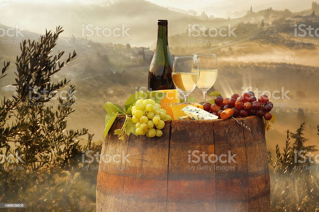 White wine with barrel on vineyard in Chianti, Tuscany, Italy stock photo