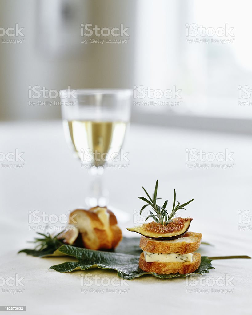 White wine with fig appetizer stock photo