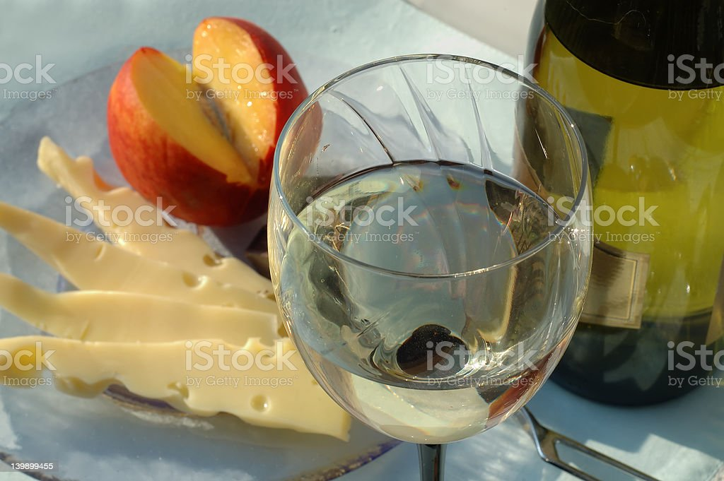 White wine with sliced cheese and fruit royalty-free stock photo