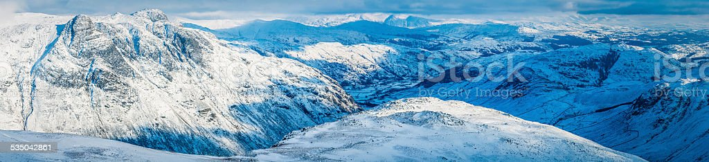 White winter landscape snowy mountain peaks panorama Lake District Cumbria stock photo