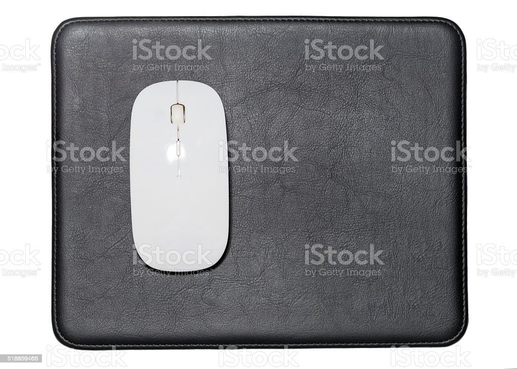 White Wireless Mouse on Black Leather Pads stock photo