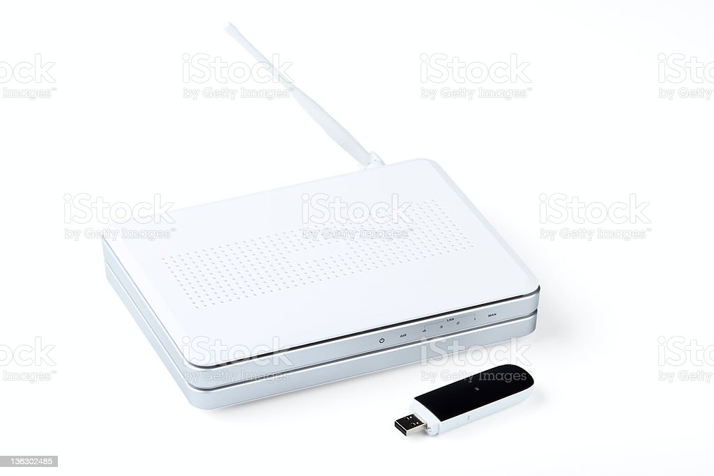White wireless router and usb modem stock photo