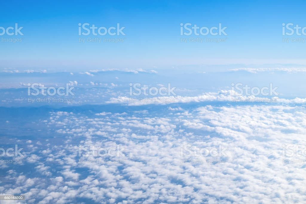 white wispy cirrus and cirrostratus clouds taken from airplane stock photo