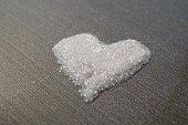 white with rainbow glitter powder heart on grey