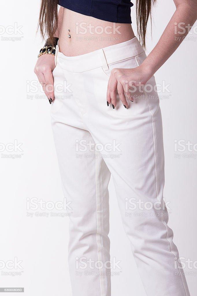 White women trousers in white background. stock photo