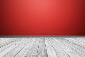 White wood floor panels with red wall. texture background
