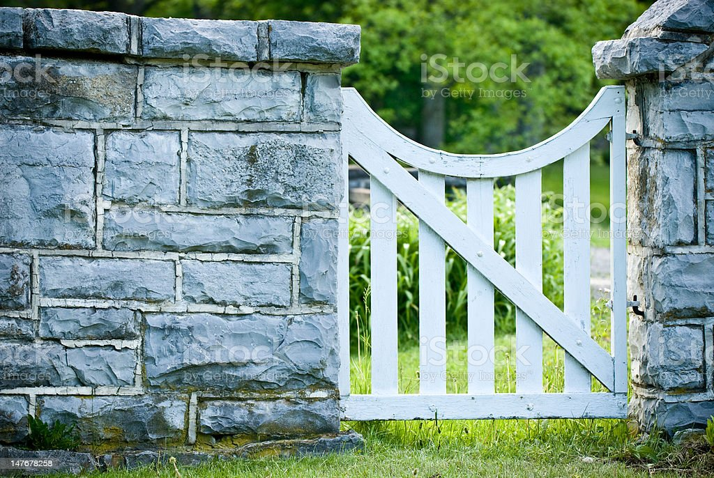 White Wood gate to a garden stock photo