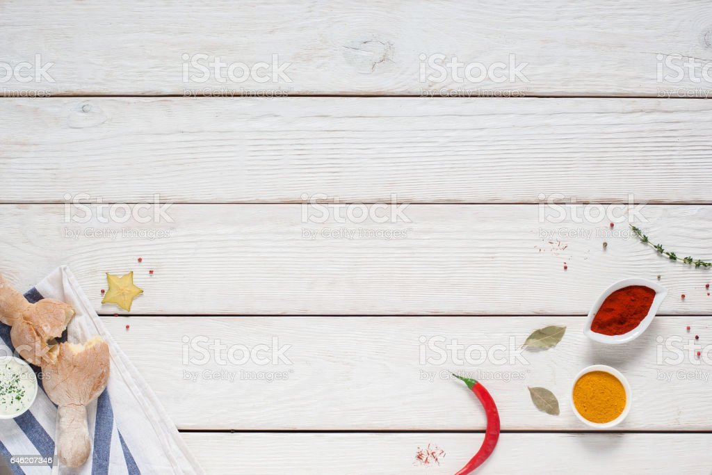 White wooden background with bread and spices stock photo
