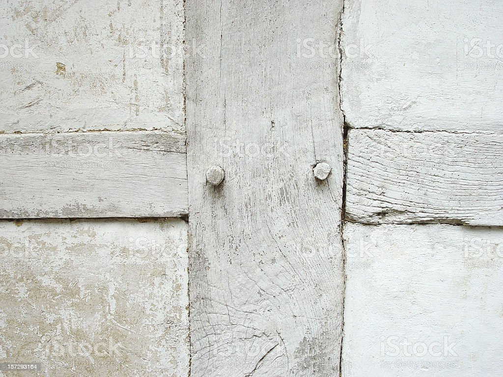 White wooden cross as part of a wall royalty-free stock photo