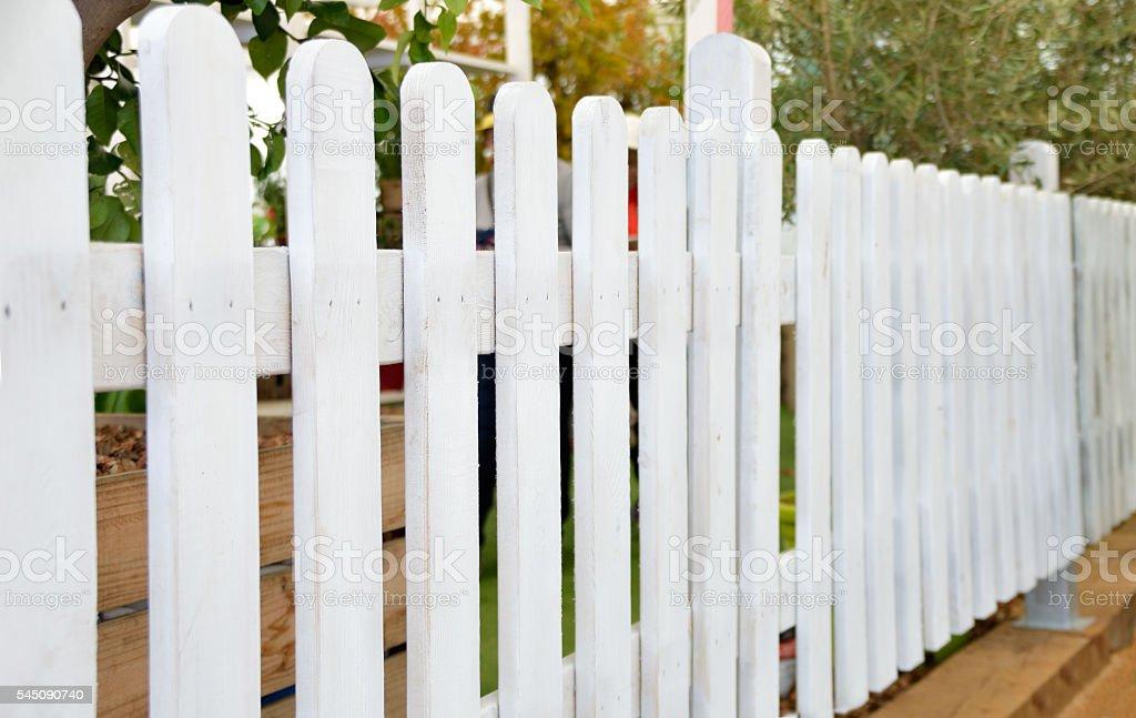white wooden fence stock photo