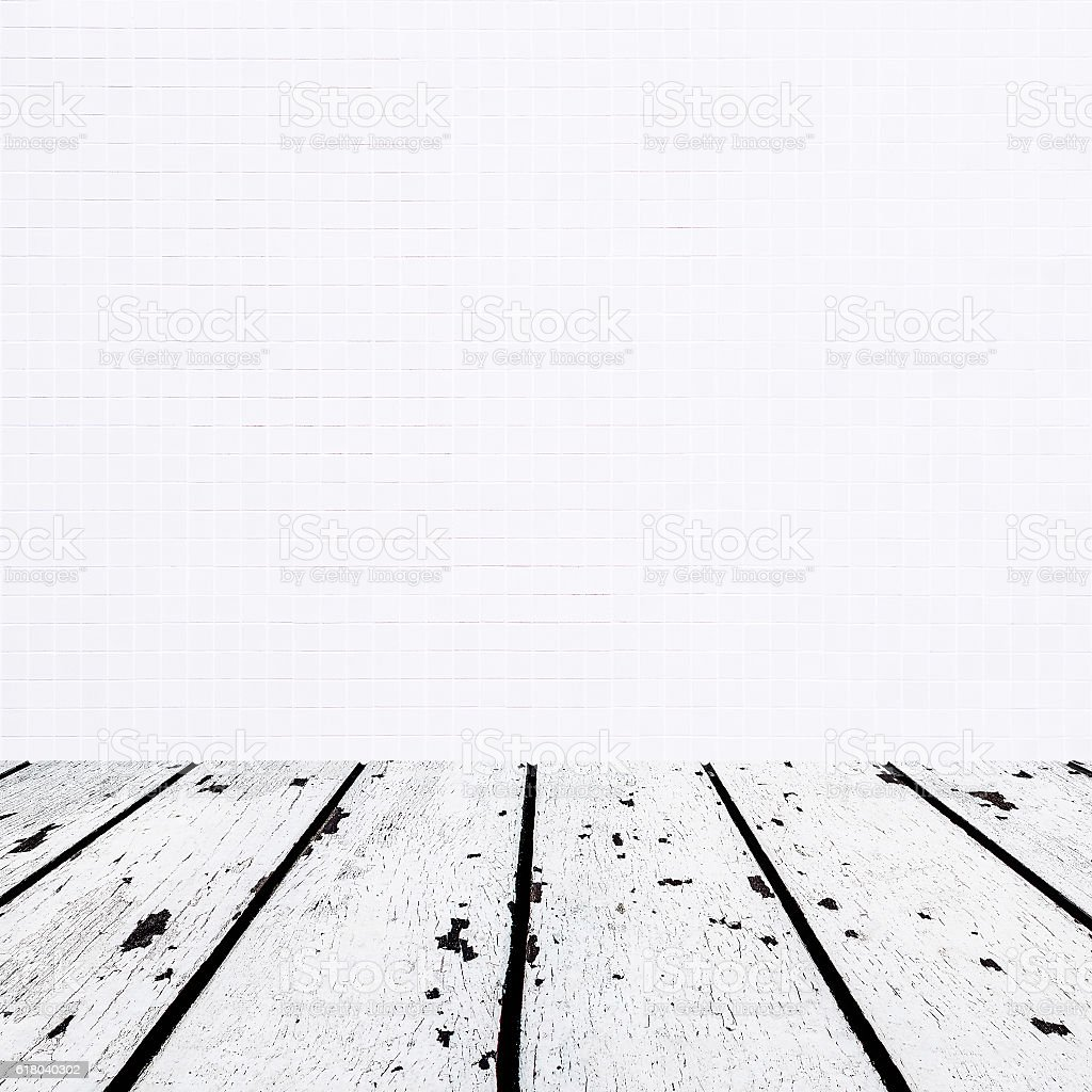 white wooden floor and small white mosaic front stock photo