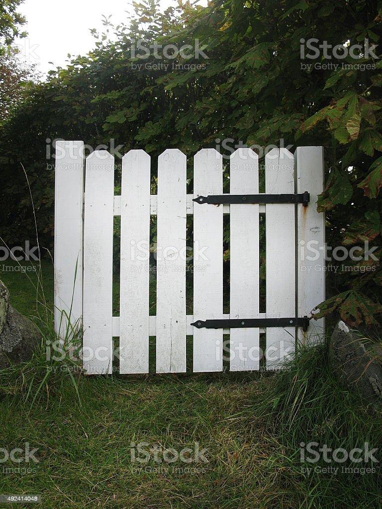 White wooden gate stock photo