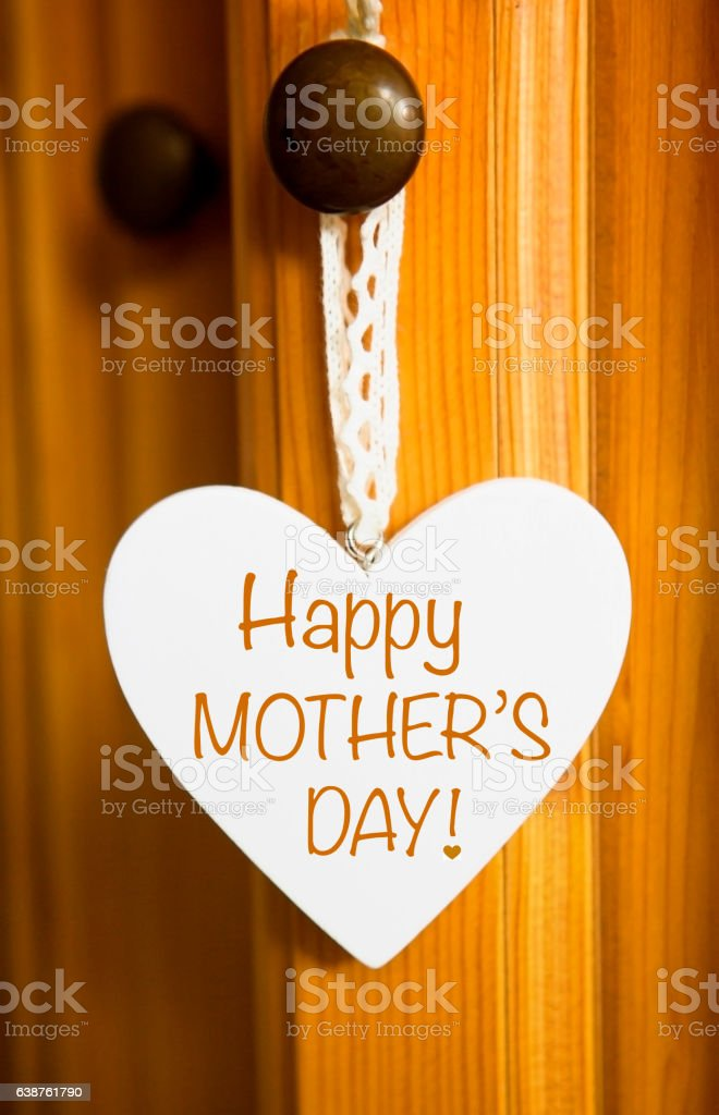 white wooden heart with the words Happy Mothers Day stock photo