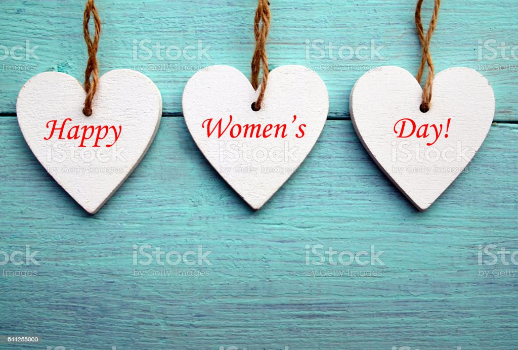 White wooden hearts on a blue wooden background.Happy Women's Day. stock photo