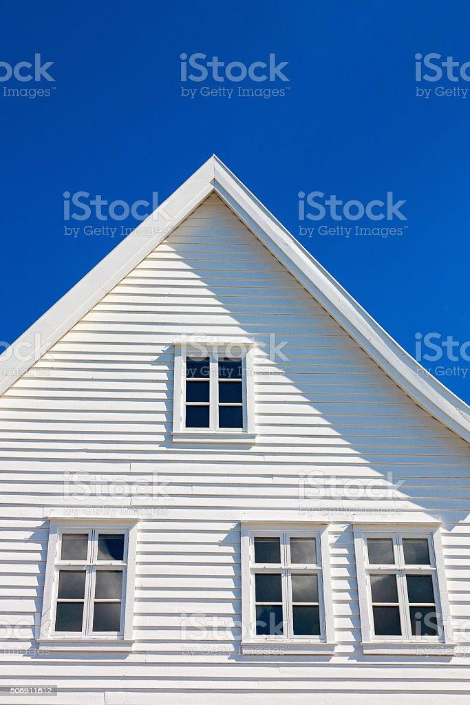 White wooden house gable against blue sky stock photo