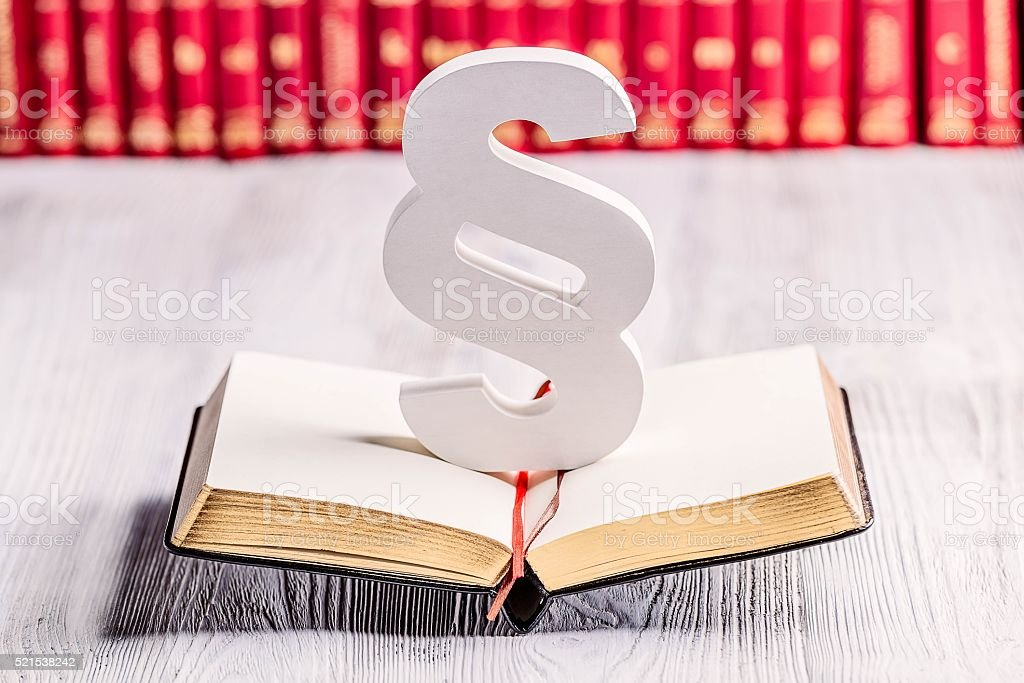 White wooden paragraph the symbol of law stock photo